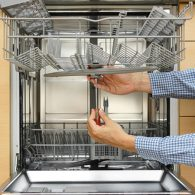 Repairman repairing a dishwasher in North Lonodn!