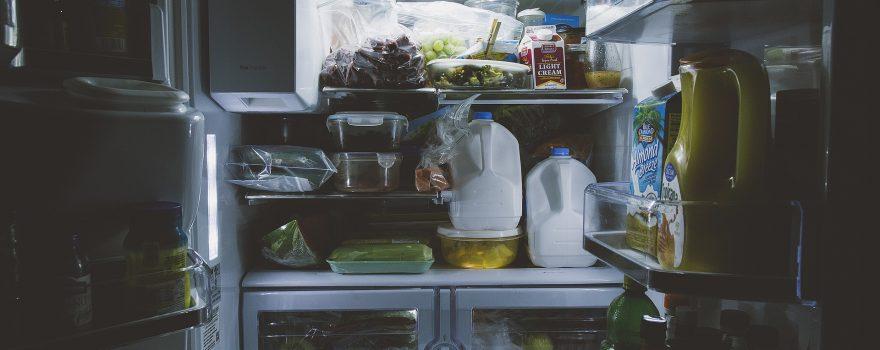 Open refrigerator full of food