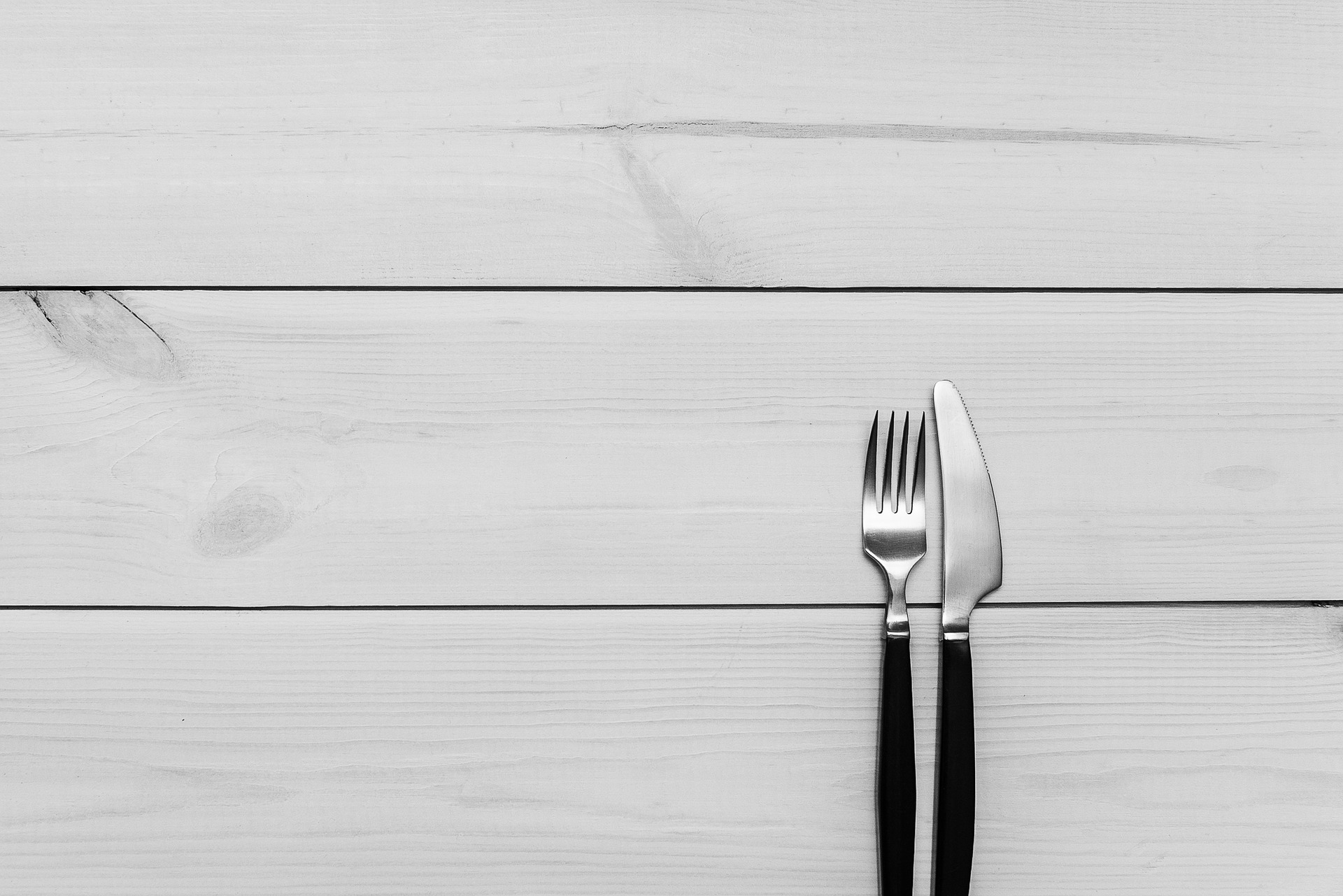 fork and knife on gray surface