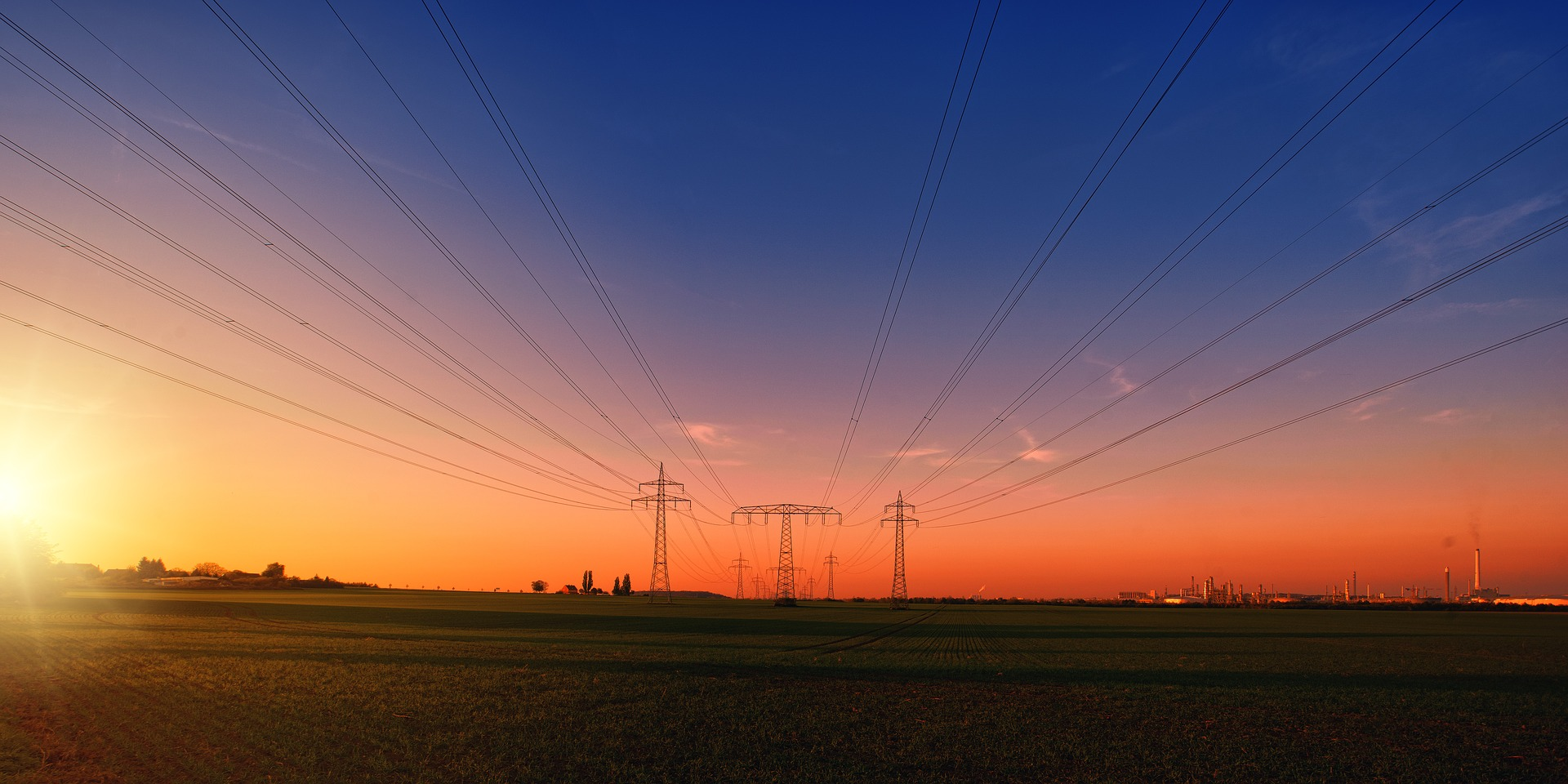 electric poles with sunset background