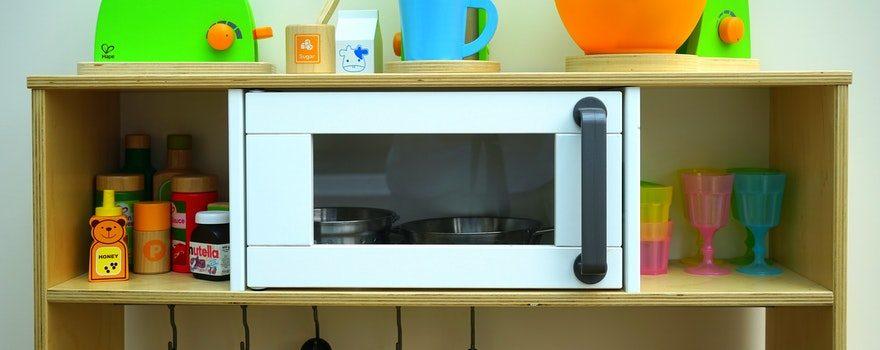 microwave oven on a shelf