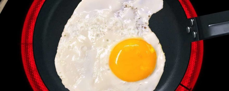 egg cooking in an induction pan